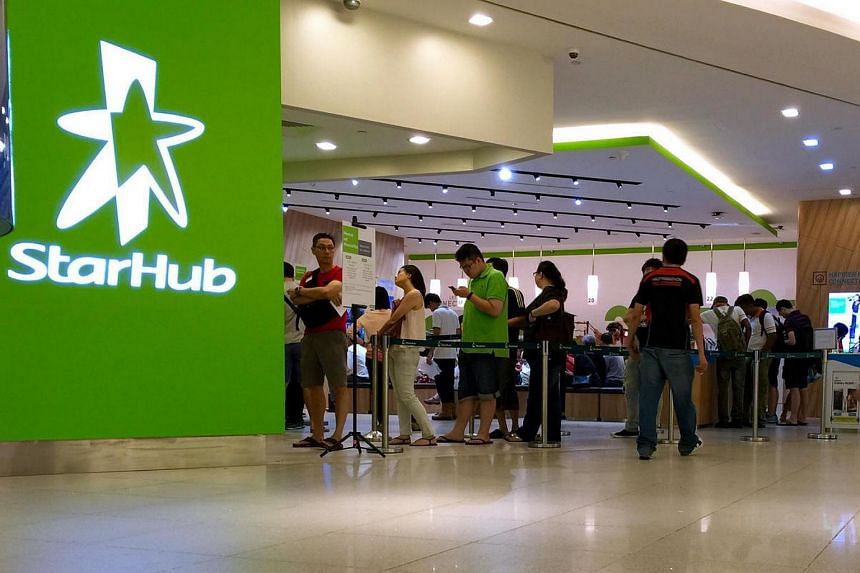Customers at a StarHub retail outlet on May 5.