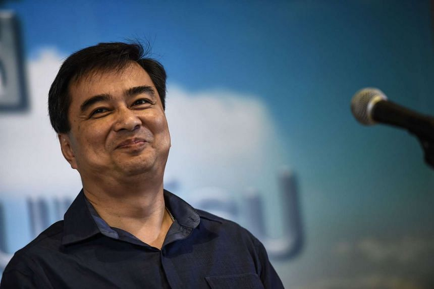 Democrat party leader Abhisit Vejjajiva speaks to the press at their headquarters in Bangkok on July 27, 2016.