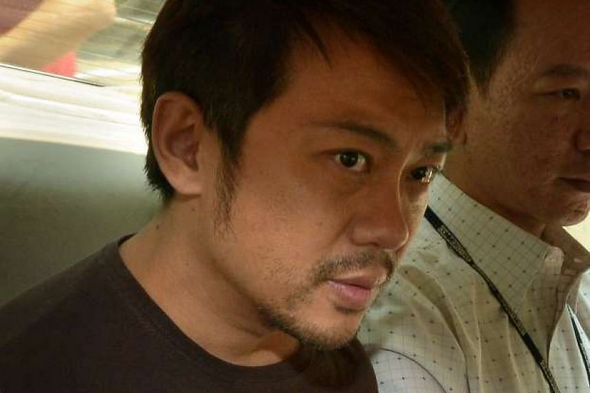 Yang Yin seen in a police car on Nov 5, 2014. He has changed his mind and will not be pleading guilty.