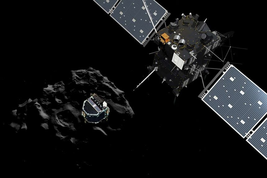A handout file artist impression showing the European probe Philae separating from its mother ship Rosetta and descending to the surface of comet 67P/Churyumov-Gerasimenko.