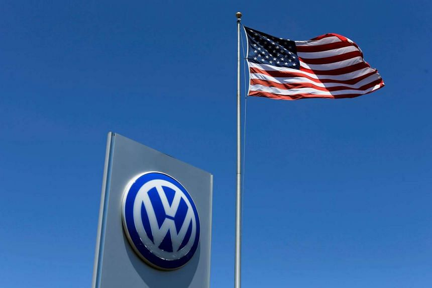 A US flag flutters above a Volkswagen dealership in Carlsbad, California, May 2, 2016.