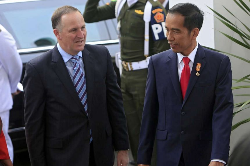 Indonesian President Joko Widodo (right) welcomes New Zealand Prime Minister John Key to Indonesia on July 18, 2016.