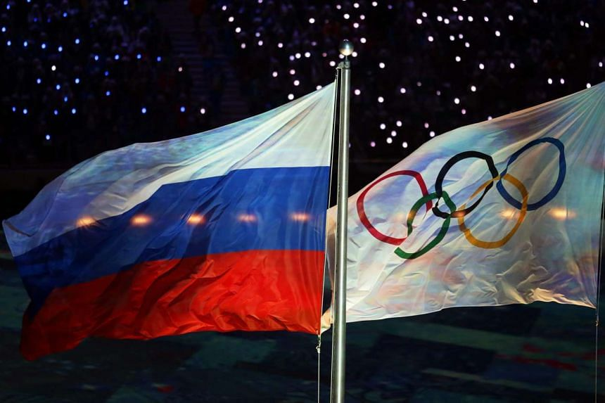 The Russian flag (left) and the Olympic flag during the Closing Ceremony of the Sochi winter Olympic games in 2014.