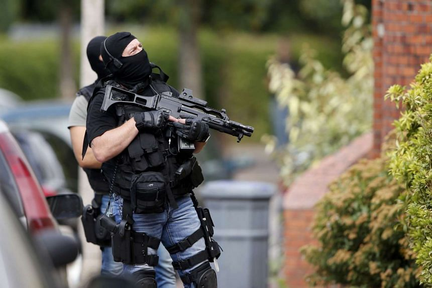 Members of French special police forces are seen during a raid after a hostage-taking in the church in Saint-Etienne-du-Rouvray.