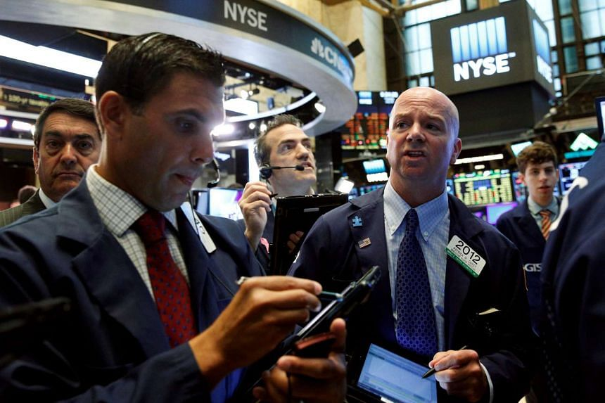 Traders work on the floor of the New York Stock Exchange in New York City on July 26, 2016.