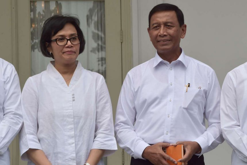 Security Minister Wiranto (right) with Finance Minister Sri Mulyani at the press conference announcing Indonesia's new Cabinet ministers, at the presidential palace in Jakarta on July 27, 2016.