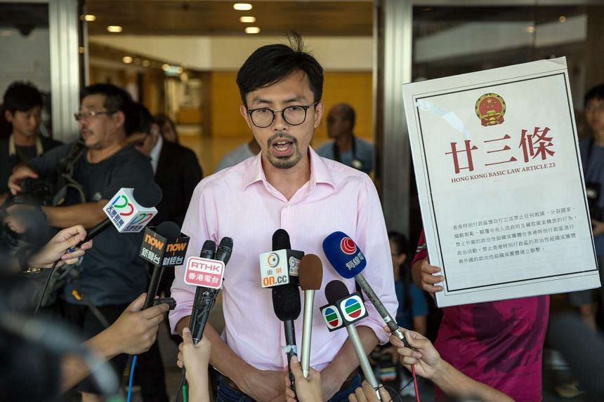 Avery Ng, chairman of the League of Social Democrats, speaks to member of the media before entering the High Court in Hong Kong on July 27, 2016.