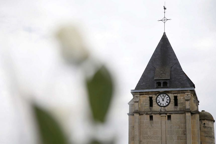 A white rose is attached to a post in front of the church a day after a hostage-taking in Saint-Etienne-du-Rouvray in Normandy, France on July 27, 2016.