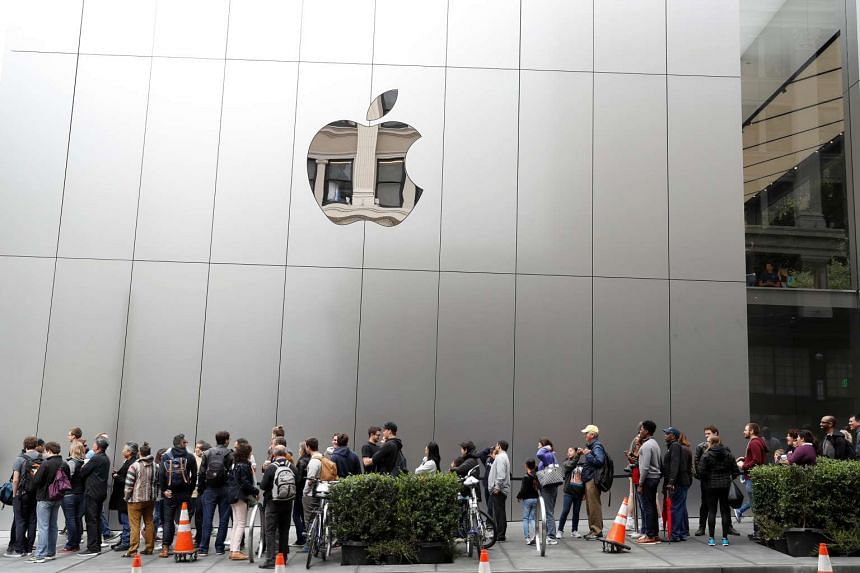 Apple shares soared 7.4 per cent to US$104.47 after the company sold more iPhones than expected in the third-quarter.