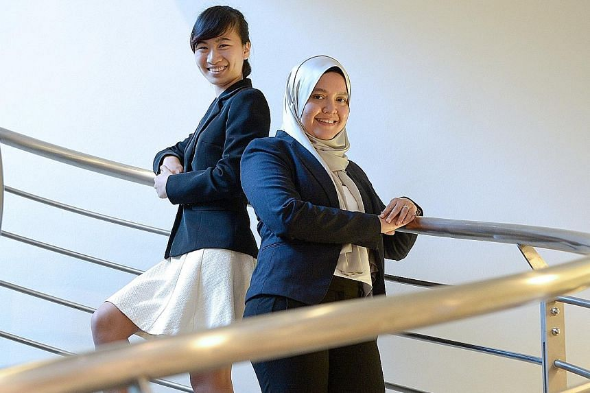 Ms Tan Guan Rong, 22 (at left), and Ms Hanisah Abdullah Sani, 32, were among 20 aspiring academics who yesterday received scholarships that will help them pursue a career in teaching and research. The Singapore Teaching and Academic Research Talent S