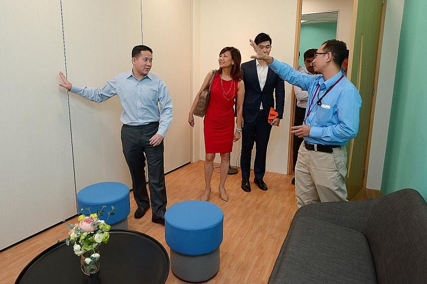 The Singapore Anti-Narcotics Association's (Sana's) new Step-Up Centre for former offenders seeking financial, emotional and employment support was officially opened by Parliamentary Secretary of Home Affairs Amrin Amin (right) yesterday. With him we