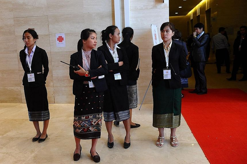 Students from the National University of Laos, armed with little more than walkie-talkies and patience, are in charge of VIP security at the Asean ministerial meeting in Vientiane.