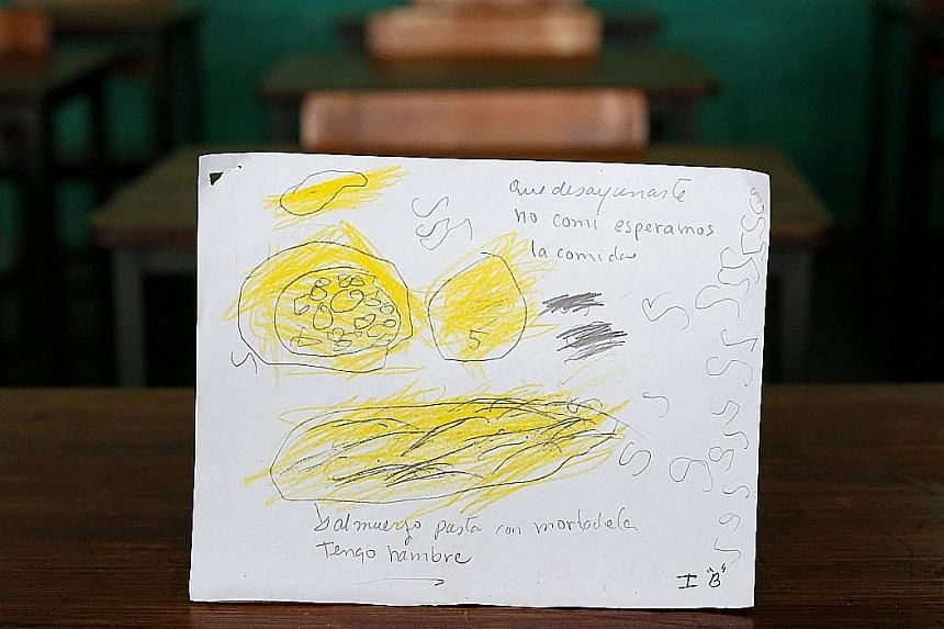 Padre Jose Maria Velaz school pupils in Venezuela draw their most recent meals. (Top) 'Today and yesterday, I ate bread for breakfast; yesterday, I had sardine with yucca, butter and water for lunch and had nothing for dinner.' (Centre) 'Ate a corn c
