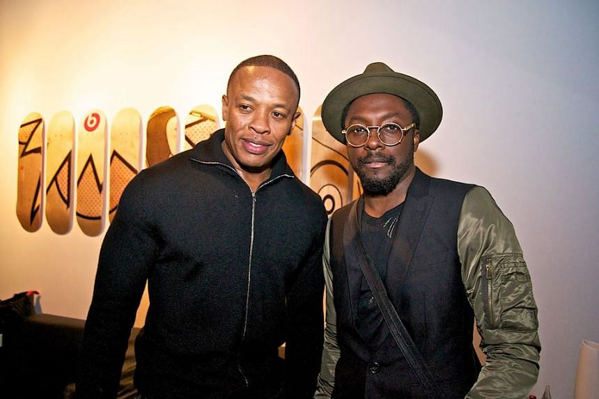 Dr Dre (left) in a photo from his Facebook page with musician Will I Am.