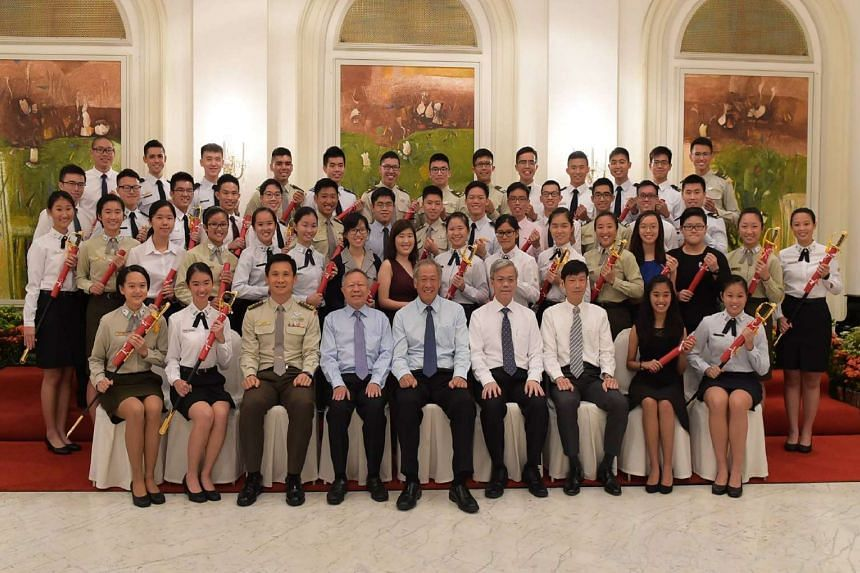 Defence Minister Ng Eng Hen (front row, centre) with the recipients of the Mindef/SAF scholarships, at the Istana on July 27, 2016.