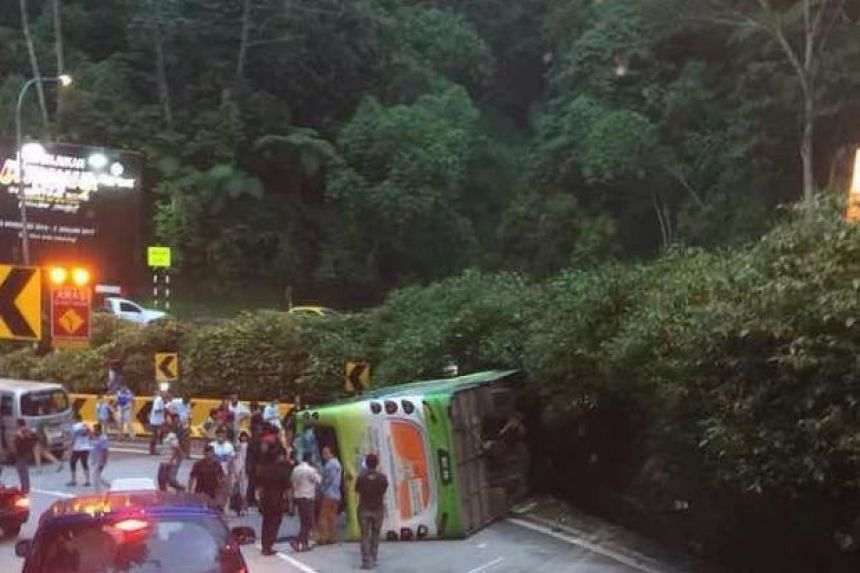 A tour bus carrying 27 people crashed at the foot of Genting Highlands, killing the driver.