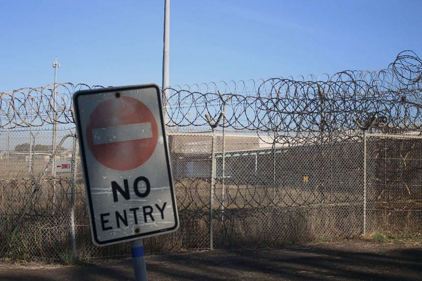 """A general view shows a sign reading """"No Entry"""" near a fence of the current Don Dale youth detention centre in Darwin, Australia on July 27, 2016."""