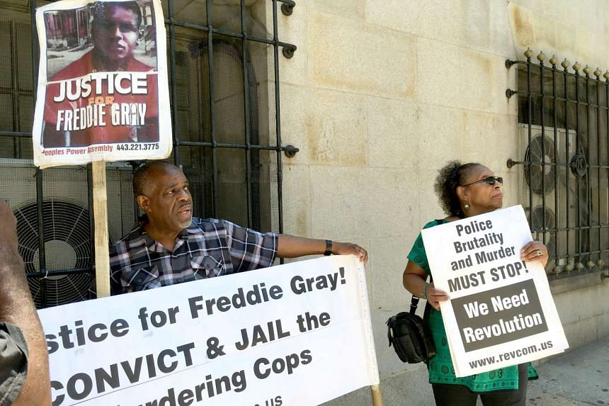 People protesting outside a Baltimore, Maryland court house on June 20, 2016 at the trial of police officer Caesar Goodson for his role in events that led to the death of Freddie Gray.