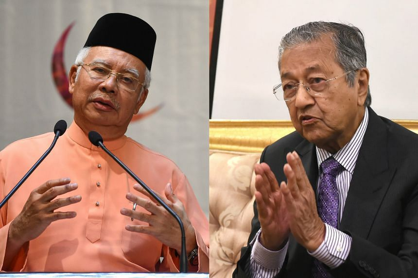 "Followers former premier Dr Mahathir Mohamad (right) have taken to labelling supporters of Prime Minister Najib Razak as people who are ""makan dedak"". PHOTOS: AFP"