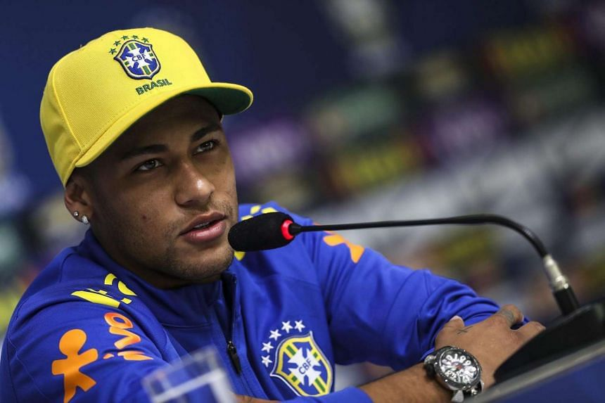 Brazilian soccer player Neymar attends a press conference after the training session of the Olympic Soccer Team, at the Comary Farm training camp, in Teresopolis, Brazil on July 26.