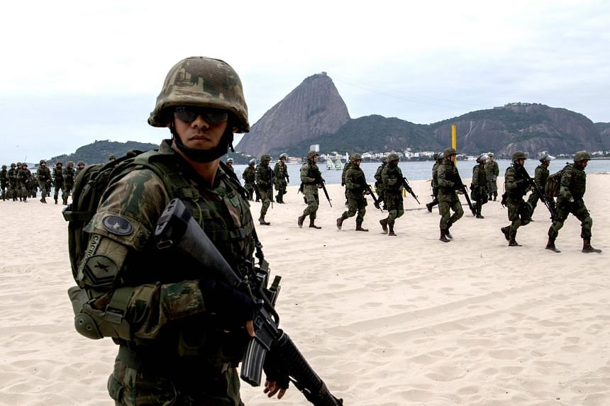 Brazilian marines disembarking on Rio de Janeiro's Flamengo Beach during a drill on July 19. About 85,000 police and security personnel have been deployed around the city by the Brazilian government.