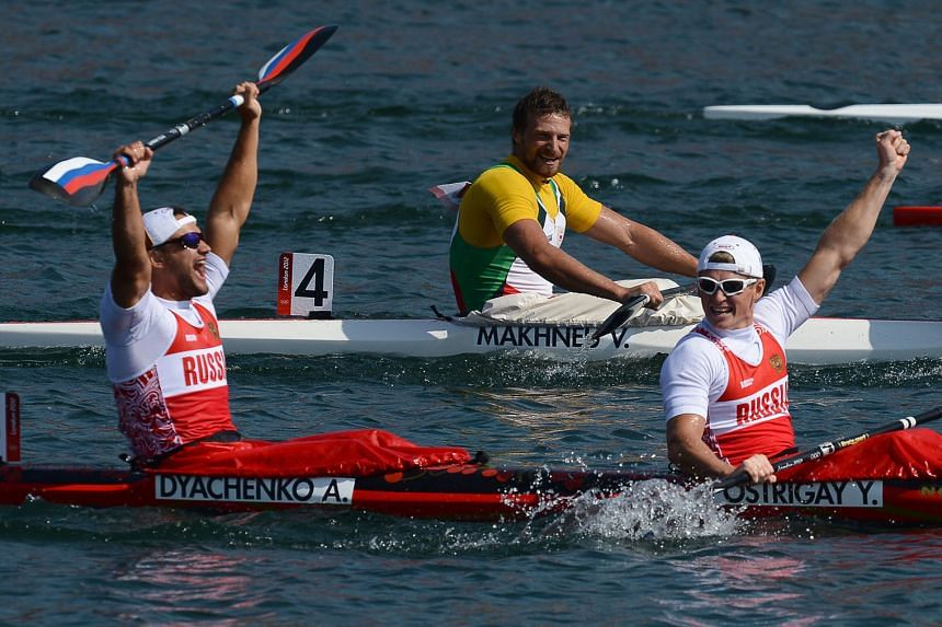 Russia's Alexander Dyachenko (left) and Yury Postrigay after winning the K2 200m at the London Olympics. Dyachenko is the only gold medallist banned so far.