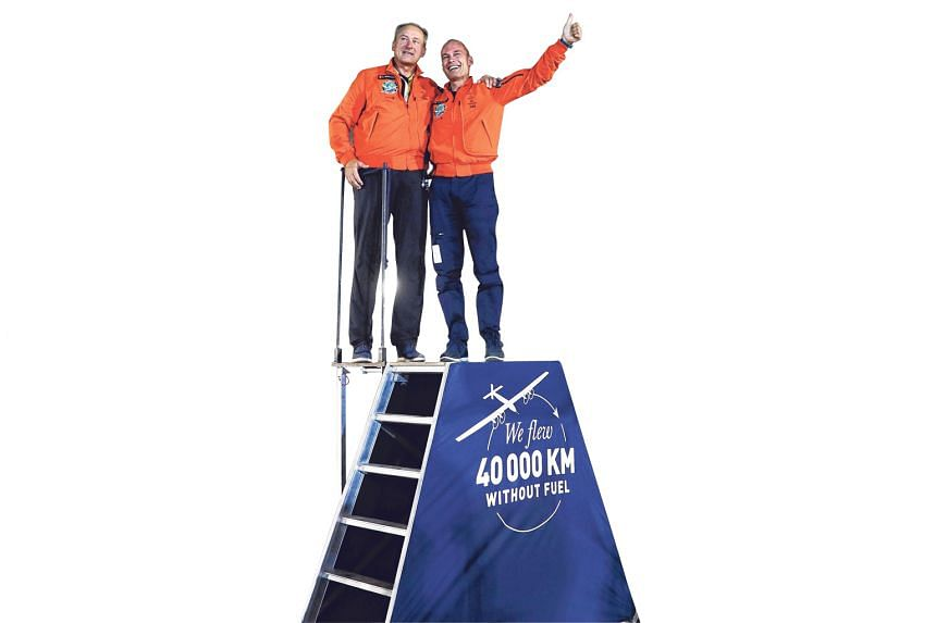 Pilots Bertrand Piccard (at right) and Andre Borschberg on cloud nine after their epic undertaking. The final leg of their project capped a 40,000km journey across four continents, two oceans and three seas.