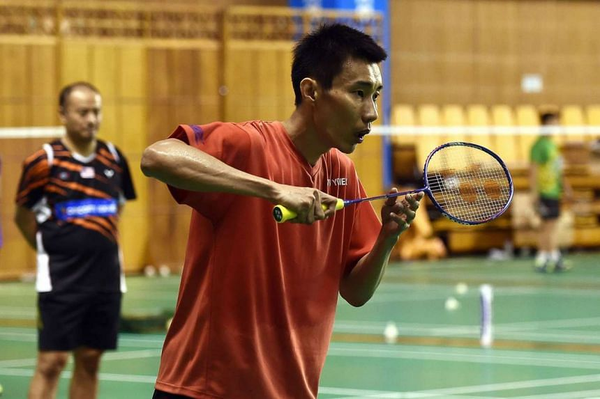 Malaysian world No. 1 Lee Chong Wei, watched by coach Hendrawan in training, hopes to overcome Lin Dan, his conqueror in the 2008 and 2012 final.