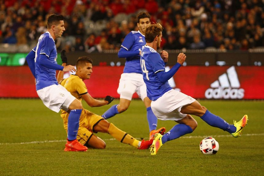 Tottenham's Erik Lamela (in yellow) grabbing a consolation goal for his side in their 2-1 defeat by Serie A champions Juventus in Melbourne.