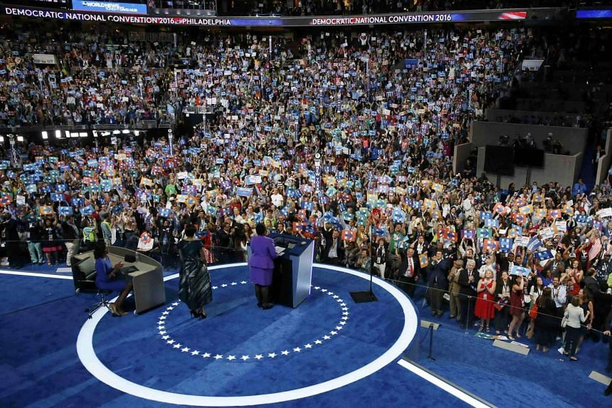 Delegates hold signs in support of Democratic US presidential nominee Hillary Clinton at the Democratic National Convention.