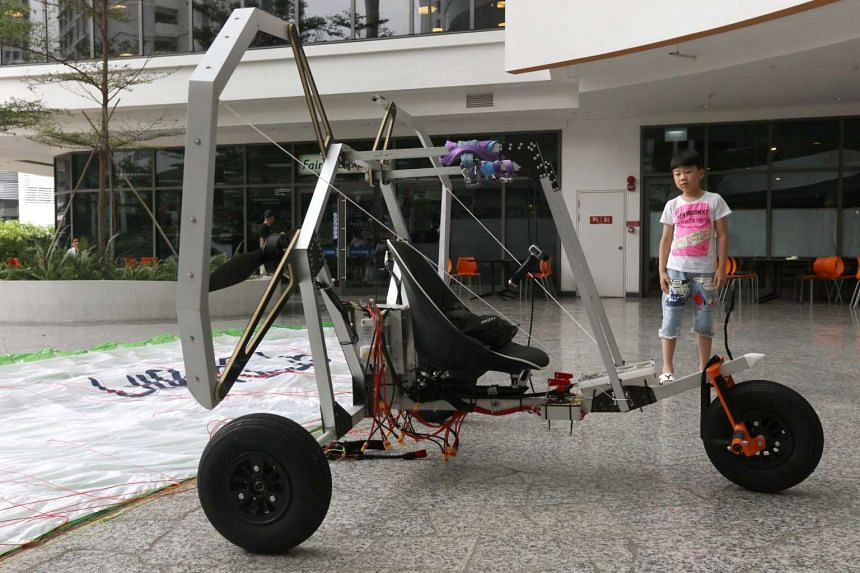 A team of NUS engineering students have successfully designed and built the world's lightest electric paraglider trike, dubbed The Delta.