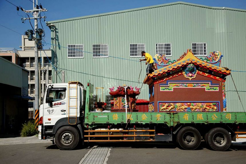 A ready-made Chinese traditional temple is seen on a lorry during delivery to a customer in Taichung, Taiwan on July 6, 2016.