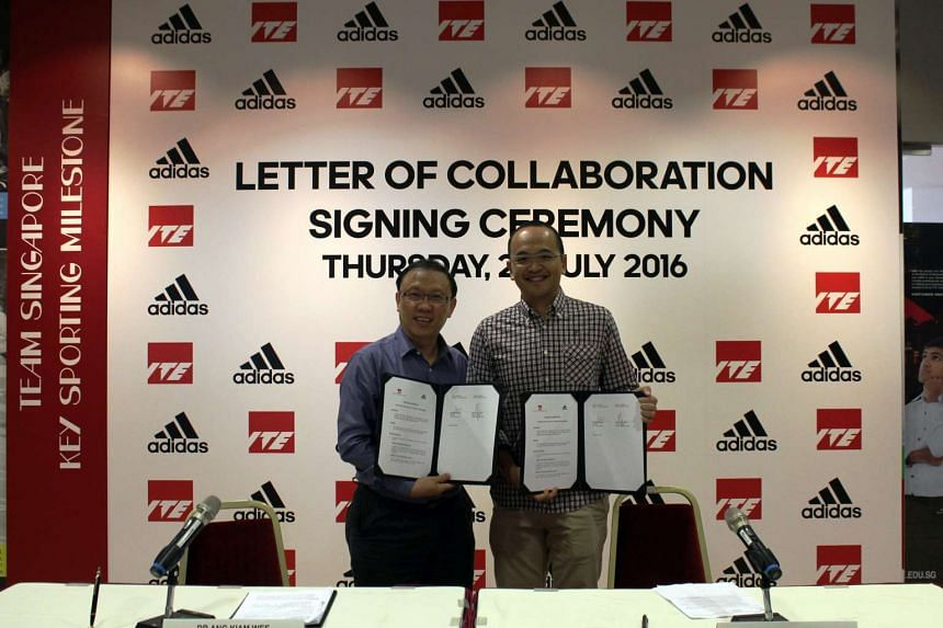 Dr Ang Kiam Wee (left), principal of ITE College Central, and Ng Chee Loon, Adidas country manager, ink a five-year ITE-Adidas partnership to groom talented students in sports.