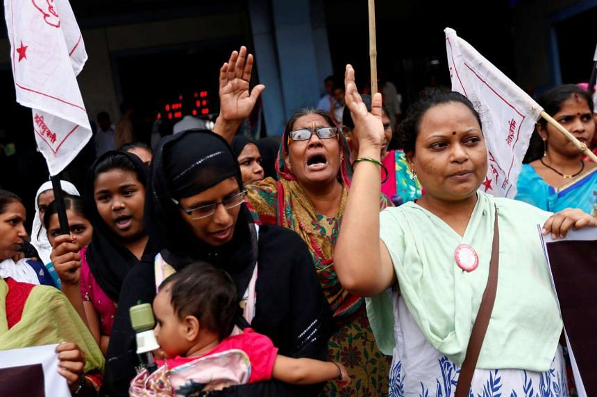 People shout slogans in a protest against what they say are attacks on India's low-caste Dalit community in Mumbai, on July 27, 2016.