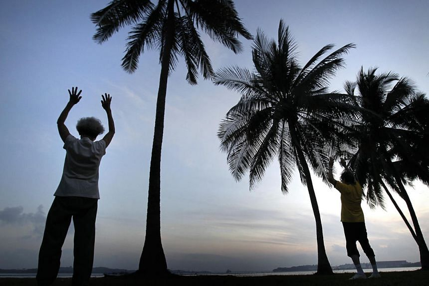 An elderly woman seen exercising at dawn at Pasir Ris beach. Researchers at Duke-NUS Medical School have found that low vitamin D levels signal cognitive impairment in elderly Chinese people.
