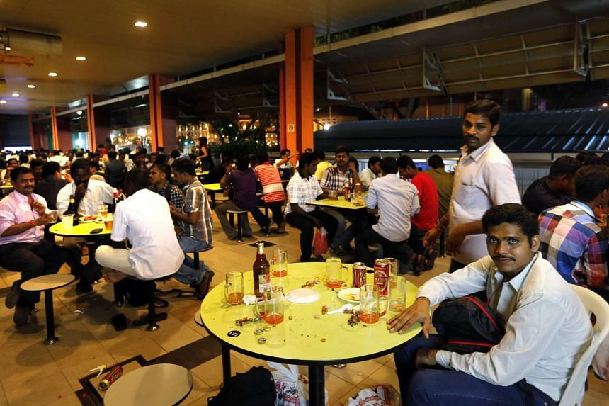 People drinking beer at Tekka Centre's hawker centre on Sept 28, 2014.