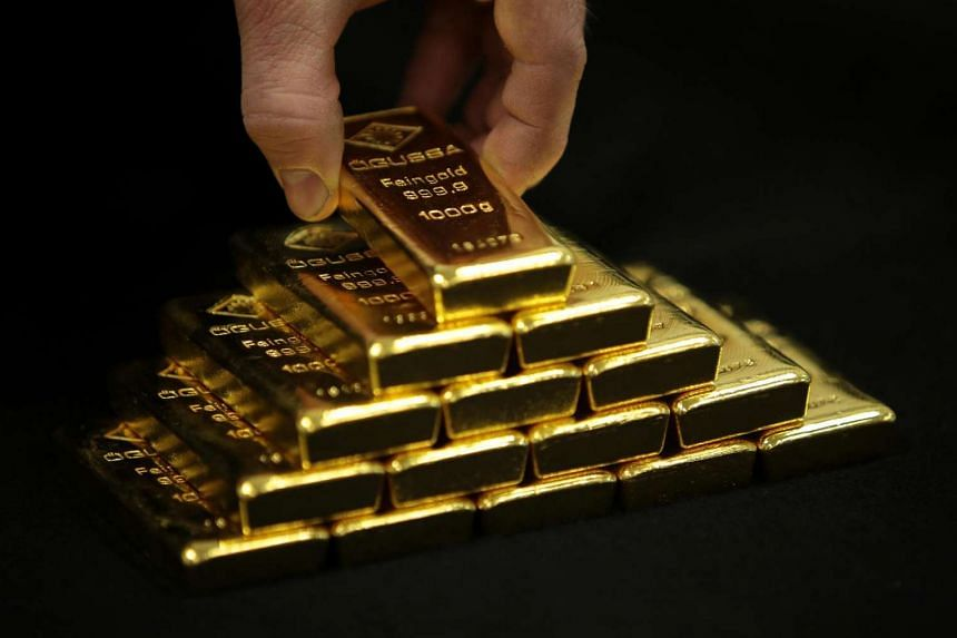 An employee arranges a display of one kilogram gold bars for a photograph in Vienna, Austria, in January 2015.