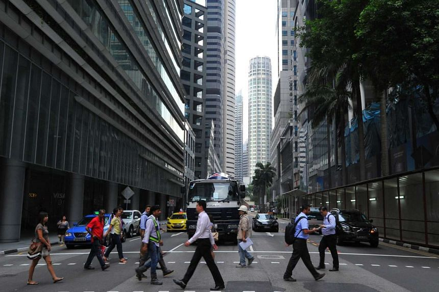 People at Robinson Road in the Central Business District (CBD) after office hours.