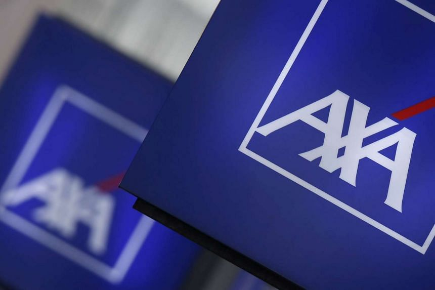 Logos of France's biggest insurer Axa are seen on a building in Nanterre, near Paris on March 8.