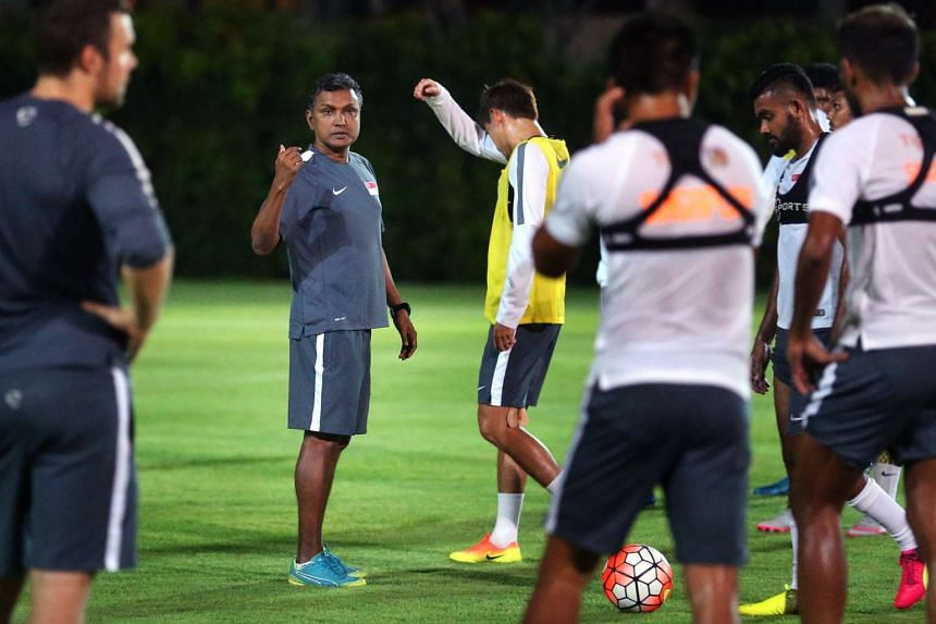 National coach V. Sundramoorthy (second from left) during a training session with his team at the Geylang Field on June 20, as part of the national team training day initiative which sees every Monday being set aside for the Lions to come together.