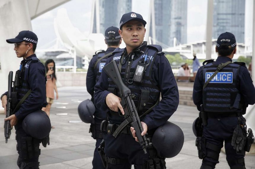 The Emergency Response Team during their patrol outside the Esplanade's outdoor theatre on July 22.
