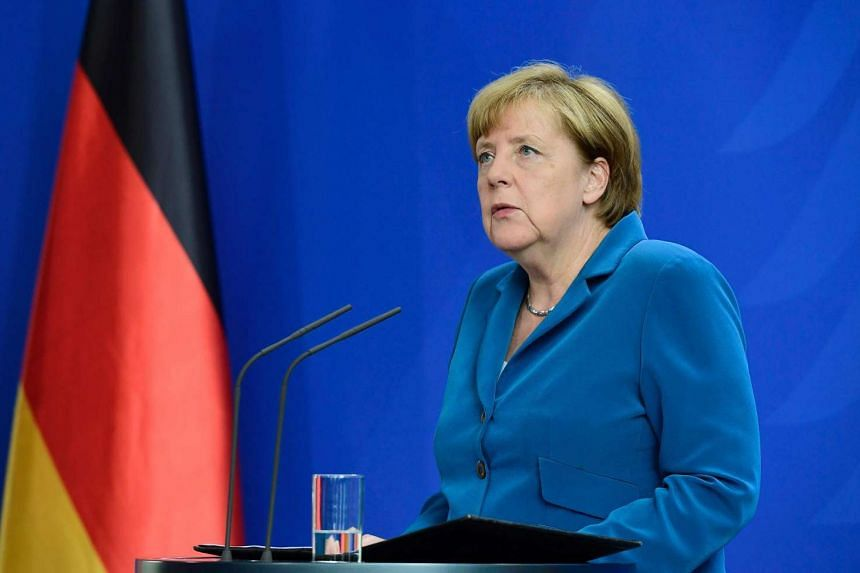 This file photo taken on July 23 shows German Chancellor Angela Merkel giving a press conference at the Chancellery in Berlin, one day after the attack at the shopping centre in Munich, southern Germany.