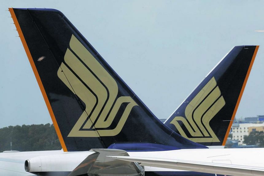 Singapore Airlines planes sit on the tarmac in Singapore's Changi Airport.