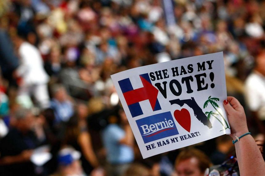 An attendee holds a sign on the third day of the Democratic National Convention at the Wells Fargo Center on  July 27 in Philadelphia, Pennsylvania.