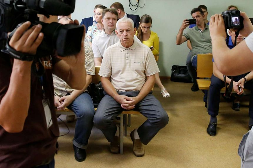 Vladimir Martynenko (centre), attends a hearing on the accident which resulted in the death of Christophe de Margerie, the chief executive of Total company, at the Solntsevo District Court in Moscow on July 28, 2016.