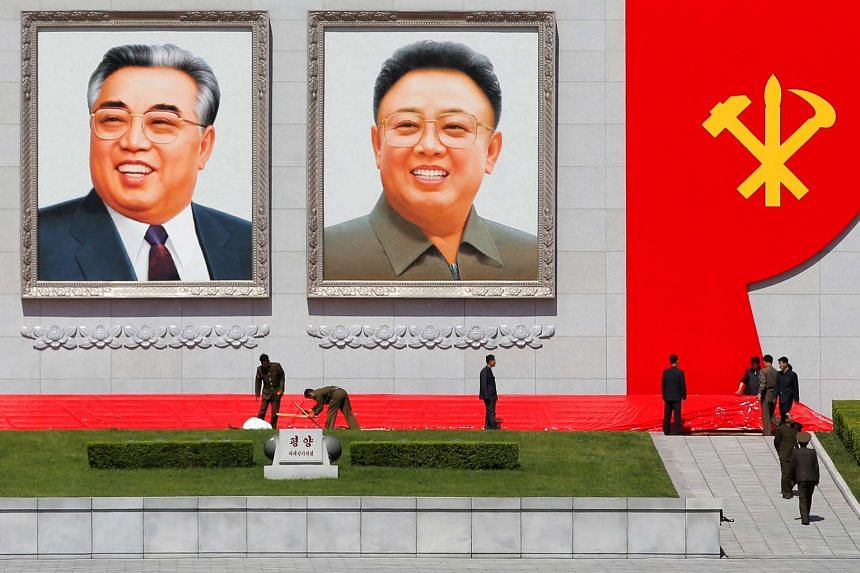 Pictures of former North Korean leaders Kim Il Sung (left) and Kim Jong Il at the main Kim Il Sung square in central Pyongyang, on May 7, 2016.