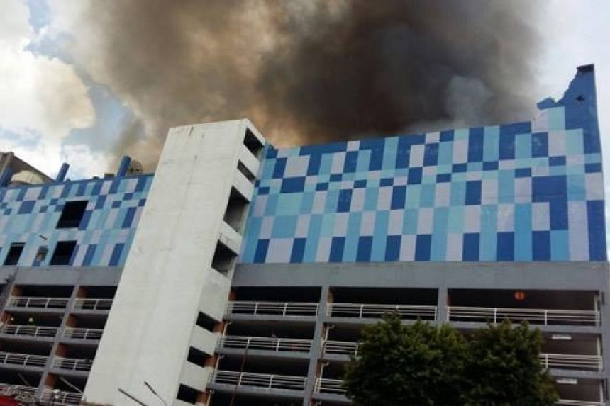 Police said the fire started at 11.15pm, adding that the roof on the third floor of the Major Cineplex Pinklao shopping mall collapsed 20 minutes later.