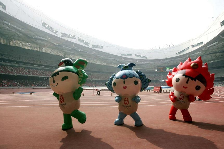 The 2008 Beijing Olympic Games mascots entertain Chinese visitors at the National Stadium in Beijing at an event before the summer 2008 Olympic Games, on April 18, 2008.
