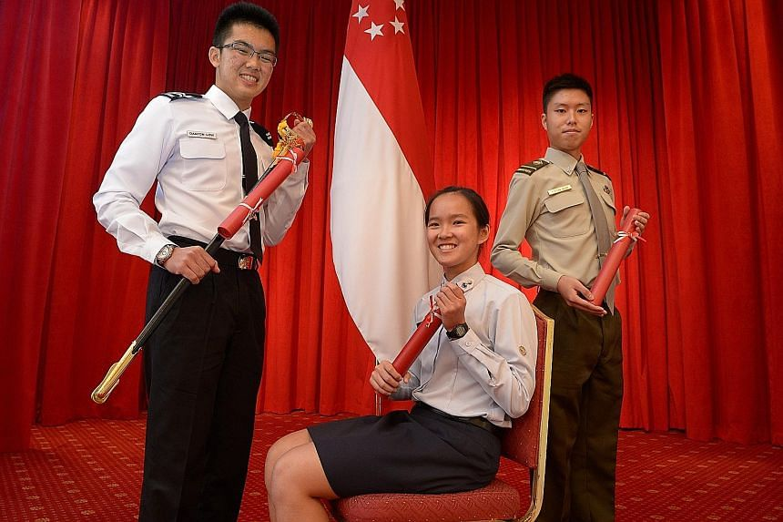 Ms Ho (centre) is one of the 47 recipients of the SAF and Mindef scholarships this year. With her are Mr Danyon Low Ming Loon (left), 19, a recipient of the SAF Scholarshipand Mr Justin Goh Shu Hao, 20, who was also awarded the new SAF Engineerin