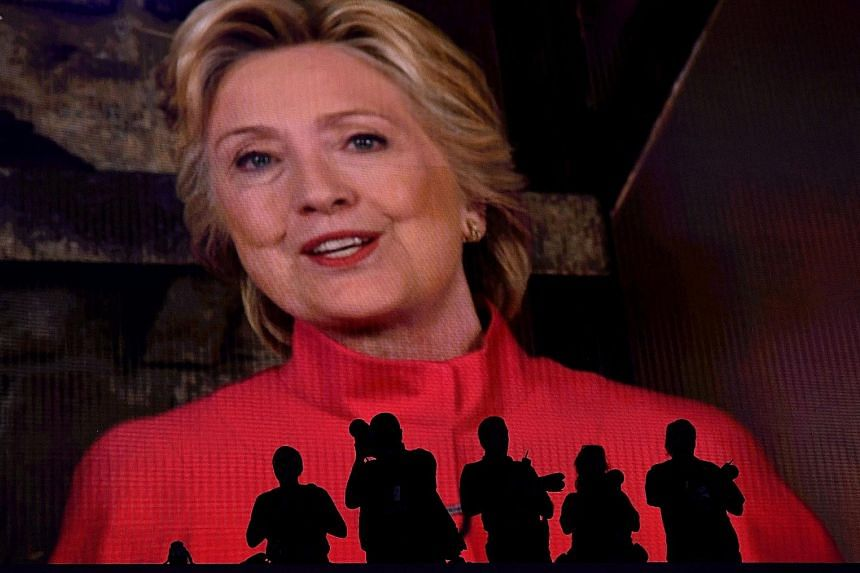 Mrs Clinton, at the Democratic National Convention in Philadelphia on Tuesday, is the first woman to become the flag-bearer of a major party.